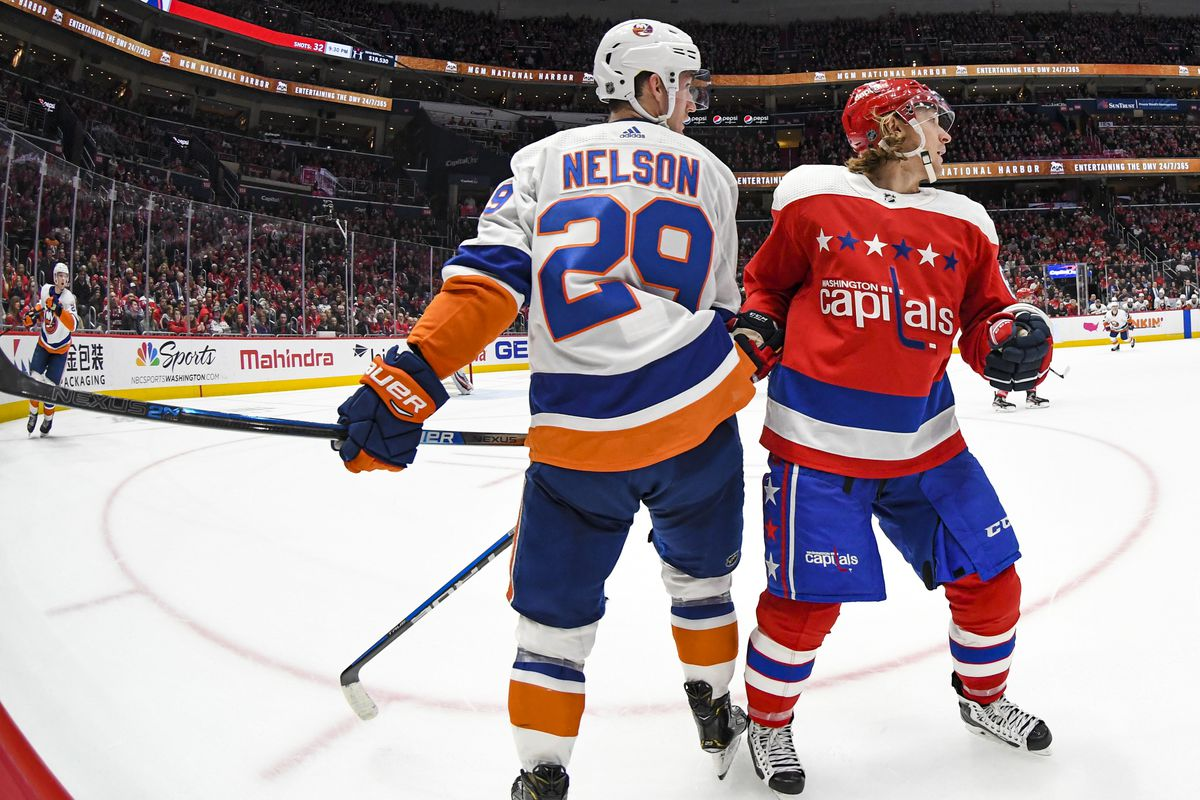 New York Islanders center Brock Nelson connects with Washington Capitals center Nicklas Backstrom in the second period on February 10, 2020 at the Capital One Arena in Washington, D.C.