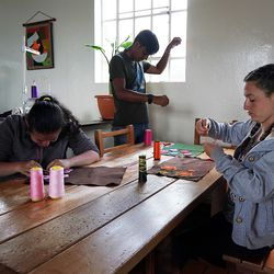 Patients sew artwork that will be sold by the Fundacion Nina Maria in Alban, Colombia, on Friday, Aug. 23, 2019.