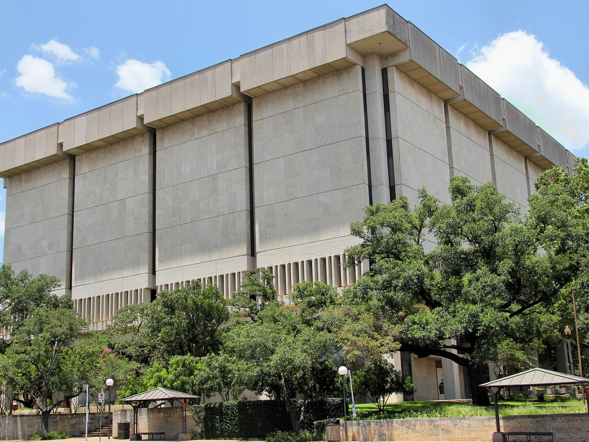 Large squarish concrete building with few windows