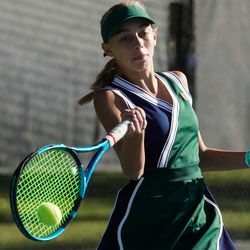 Bailey Huebner, of Green Canyon, returns a shot from Erika Olsen, of Bear River, during the final singles match of the 4A girls tennis state tournament at Liberty Park Tennis Center in Salt Lake City on Saturday, Oct. 2, 2021.