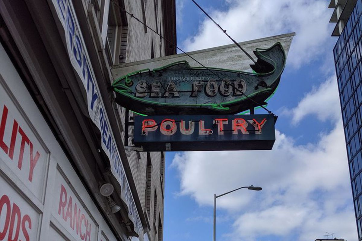The fish-shaped sign for University Seafood and Poultry in the U District.