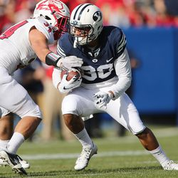 Brigham Young Cougars defensive back Eric Takenaka (33) runs against the Southern Utah Thunderbirds  in Provo on Saturday, Nov. 12, 2016.