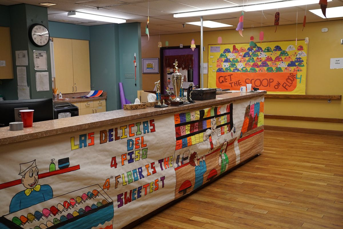 Colorful art made by unaccompanied immigrant youth adorns the lobby of a shelter run by Heartland Human Care Services in Bronzeville.