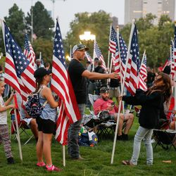 People attend a vigil to honor the life and service of Marine Staff Sgt. Taylor Hooverat the Capitol in Salt Lake City on Sunday, Aug. 29, 2021. Hoover was one of the 13 U.S. service members killed by the terrorist attack at Hamid Karzai International Airport in Kabul, Afghanistan.