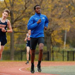 Mather's Anas Hirsi runs in the meet at River Park.