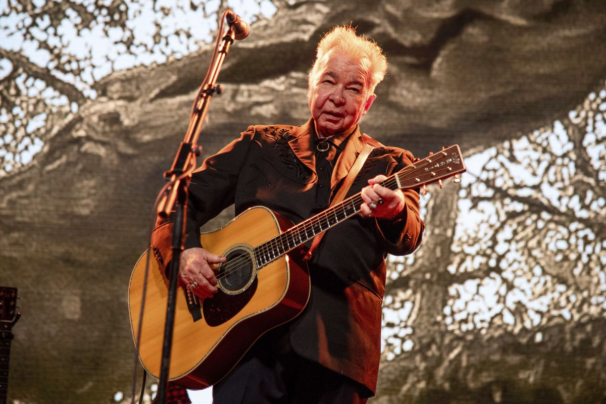 This June 15, 2019 file photo shows John Prine performing at the Bonnaroo Music and Arts Festival in Manchester, Tenn.