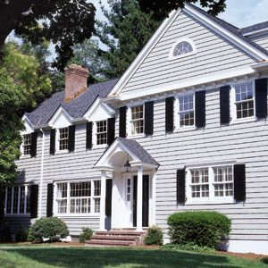 """<p>""""Nobody can believe this is the same house; they think it's much older,"""" says Ernst Hofmann of his $220,000 renovation. When adding a second story, he turned the different sizes and styles of the first-floor windows into an advantage. """"I'm a big proponent of asymmetry,"""" he says. """"It gives houses character by making them look less boxy and more casual.</p>"""