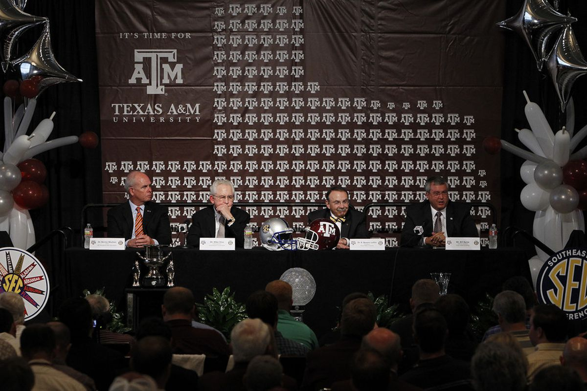 Victory. Dr. R. Bowen Loftin Celebrates A&M joining the SEC with SEC Commissioner Mike Slive, Florida President Bernie Machen, and A&M AD Bill Byrne.