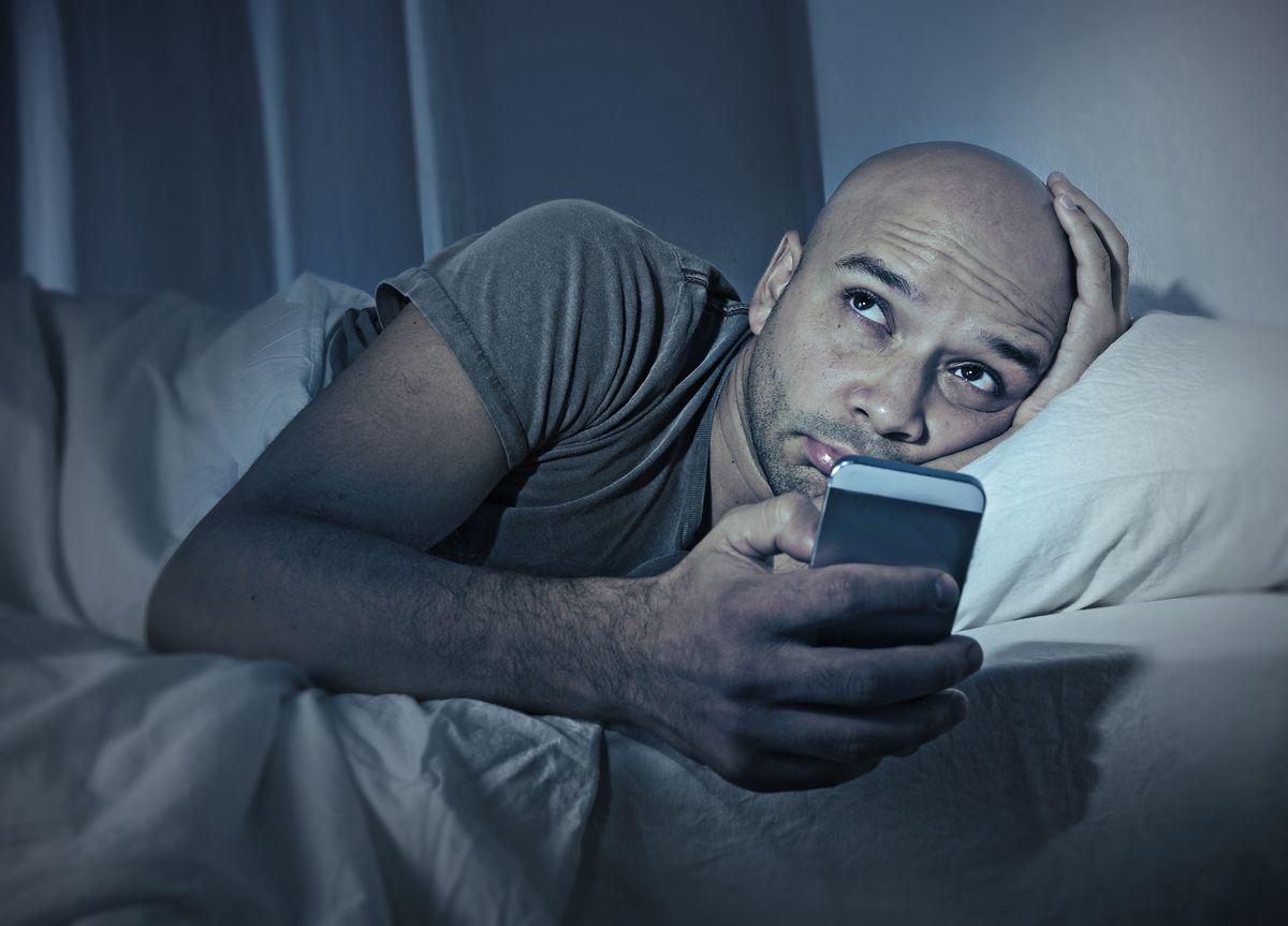 Man bed cellphone sleep