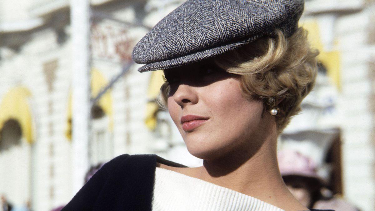 Jean Seberg, wearing a newsboy cap.= in 1965.