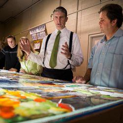 Utah Valley University President Mathew S. Holland, center, visits Tom Holdman, right, at Holdman Studios at Thanksgiving Point in Lehi on Monday Sept. 26, 2016.