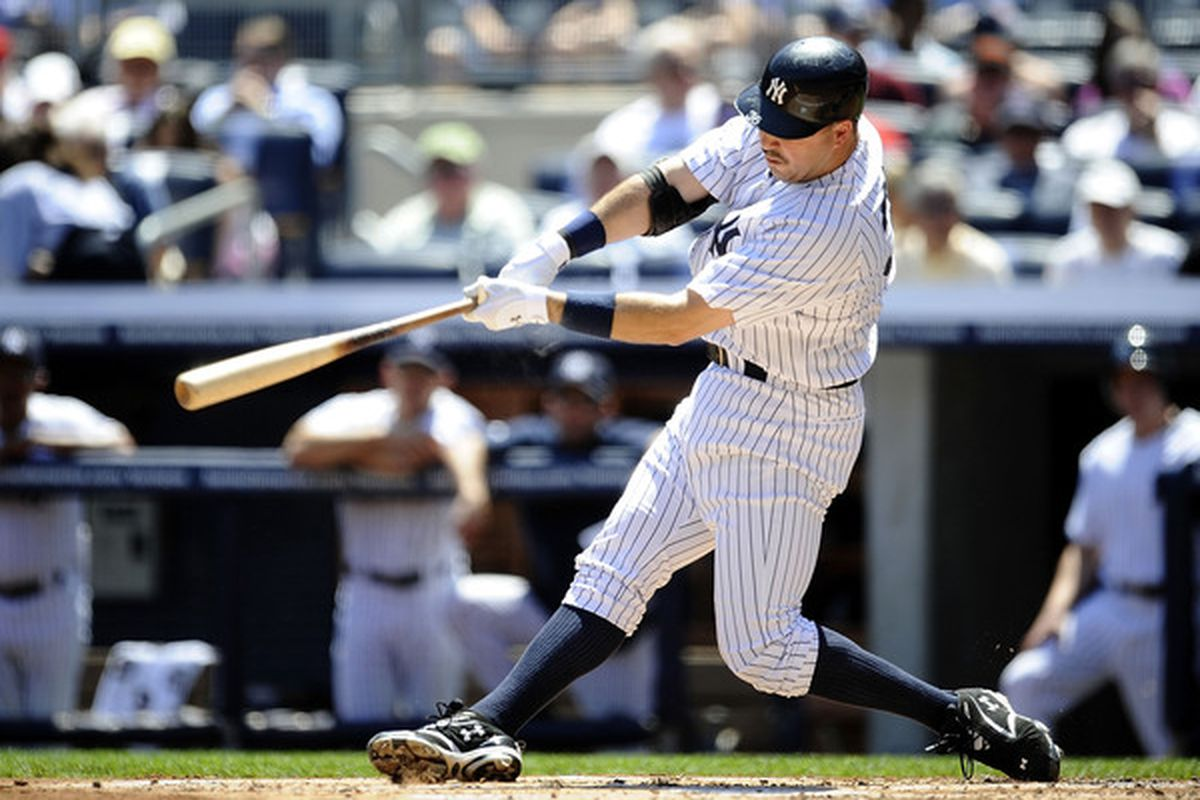 Nick Johnson hits a solo home run against the Baltimore Orioles at Yankee Stadium on May 5, 2010.  (Photo by Jeff Zelevansky/Getty Images)