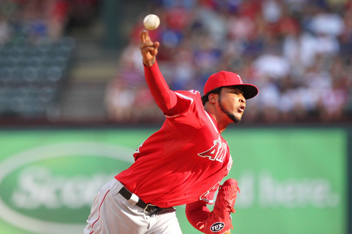 July 30, 2012; Arlington, TX, USA; Los Angeles Angels starting pitcher Ervin Santana (54) pitches in the first inning against the Texas Rangers at Rangers Ballpark.  Mandatory Credit: Matthew Emmons-US PRESSWIRE