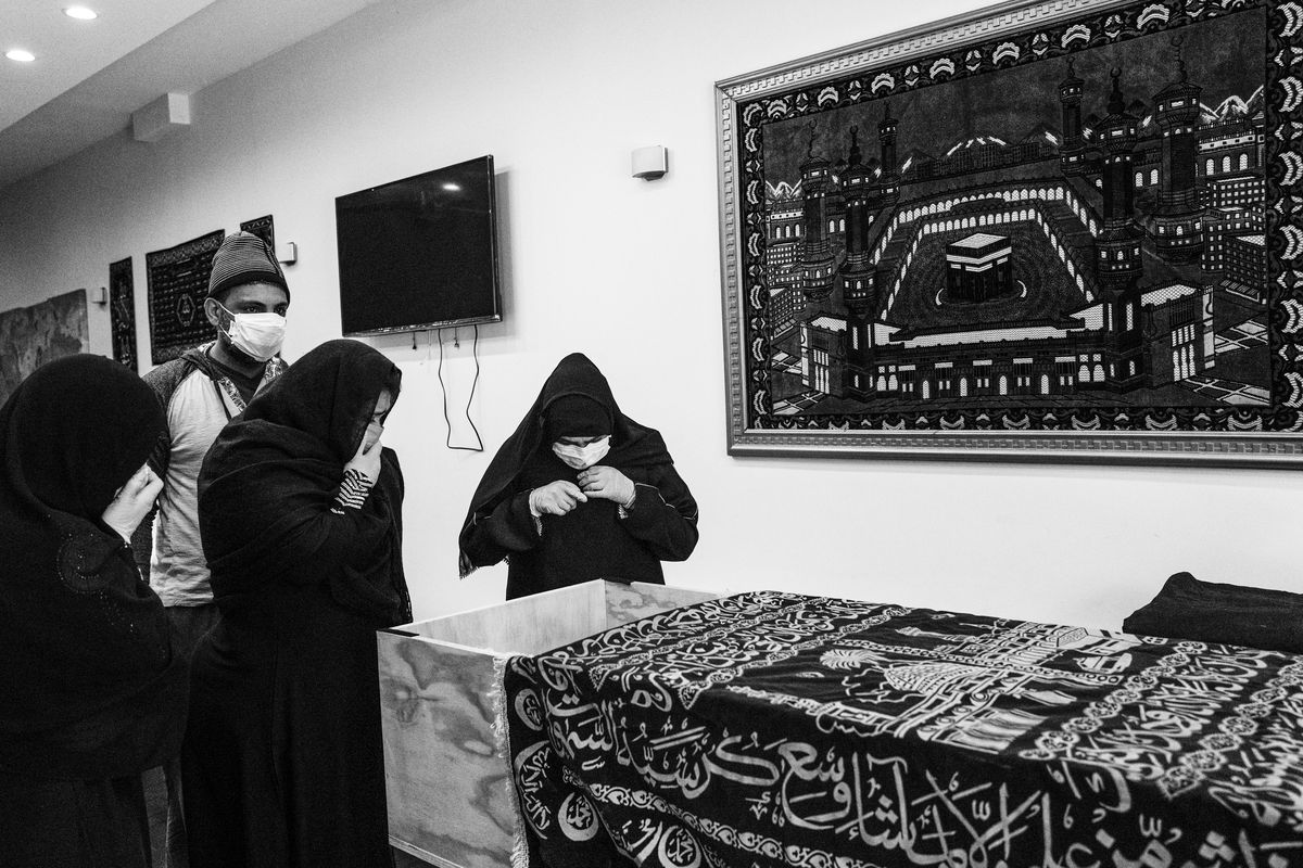 Three women mourn the deceased at Al-Rayaan.