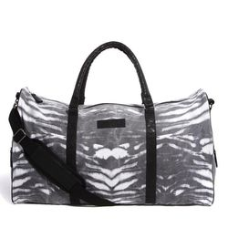 """For celebrating your getaway with a print. <a href=""""http://www.asos.com/Religion/Religion-Canvas-Weekend-Bag/Prod/pgeproduct.aspx?iid=3397503&cid=8730&Rf946=2269,2338,2261&sh=0&pge=0&pgesize=204&sort=-1&clr=Grey"""">Religion Canvas Weekend Bag</a>, $106.79 a"""