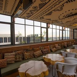 Now, the rooftop, which just about made us faint. Inspired by Frank Lloyd Wright's Ennis House on Franklin and old-school Hollywood hot spot Les Deux Cafe (pre-<i>Hills</i> era, of course!), the space features an array of unique furnishings. Favorite touc