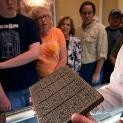 A brick of tea that dates back to the Boston Tea Party era is shown to patrons at the Independence Through History Museum in the Grand America in Salt Lake City on Friday, July 5, 2013.