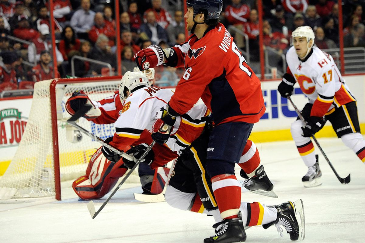 Then-Capital Dennis Wideman tripping up former Flame Brendan Morrison in January 2012.