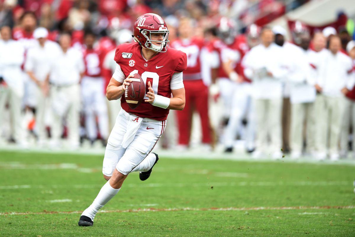 Alabama Crimson Tide quarterback Mac Jones rolls out to pass against the Western Carolina Catamounts during the second quarter at Bryant-Denny Stadium.
