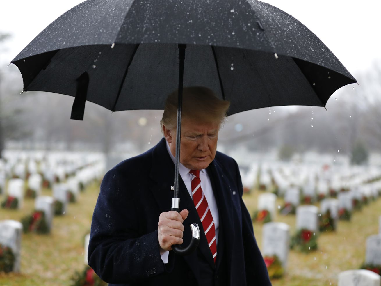 President Donald Trump visits Section 60 at Arlington National Cemetery on December 15, 2018, in Arlington, Virginia.