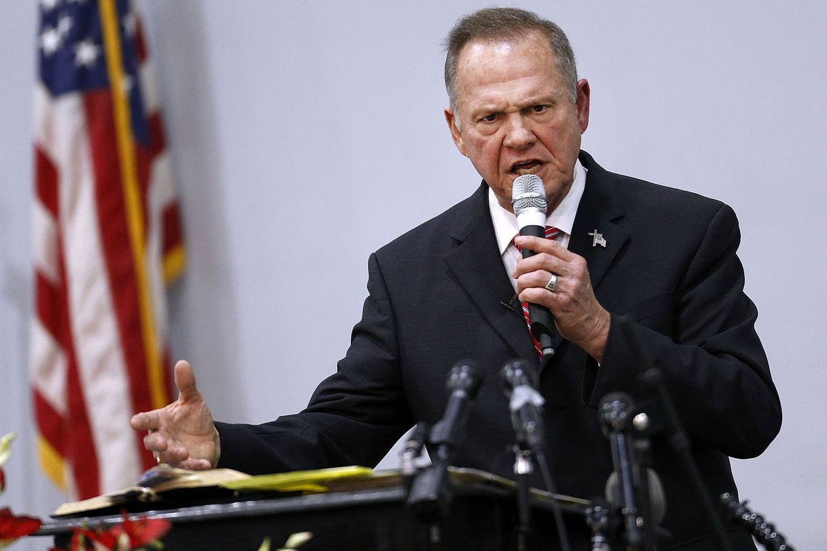 Roy Moore speaks from a lectern