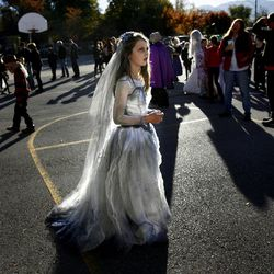 """Ella Richards, a fourth-grader at The Open Classroom, dressed as a corpse for school on Halloween in Salt Lake City on Wednesday, Oct. 31, 2012.  Sixth- and eighth-graders at the school danced to Michael Jackson's song """"Thriller"""" for the school's students and families."""