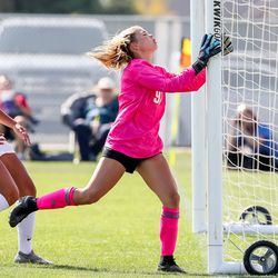 Skyridge goalkeeper Shae Toole hits the goal post as a Lone Peak goal soars into the net in a girls soccer game in Lehi on Thursday, Sept. 9, 2021.