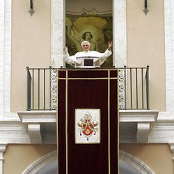 Pope Benedict XVI waves to faithful from a window of his summer residence in Castel Gandolfo, in the outskirts of Rome, during his weekly general audience Wednesday.