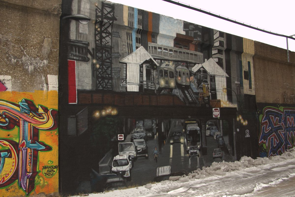 """David Orozco says he painted this cityscape so people can """"remember what we Chicagoans felt at one time"""" before the coronavirus pandemic."""