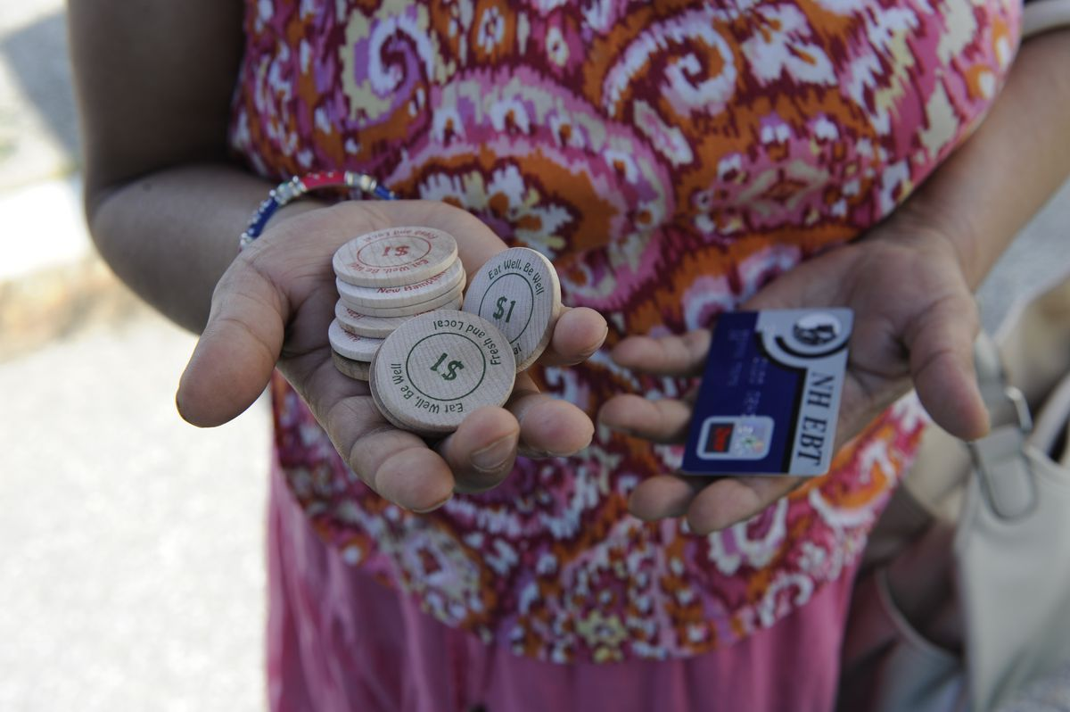 A woman has used her SNAP card to get tokens at the farmers market, which are doubled when folks buy fruits and vegetables.