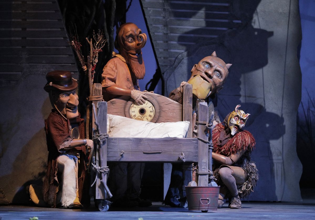"""Méphistopheles' assistant fiends, costumed in oversized masks designed and created by John Frame and Vita Tzykun, in """"Faust"""" at Lyric Opera of Chicago.   Copyright Cory Weaver"""
