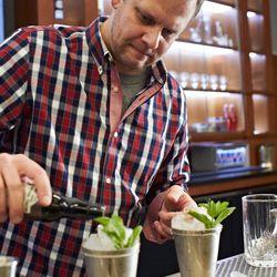 Eric Hay mixing up Mint Juleps