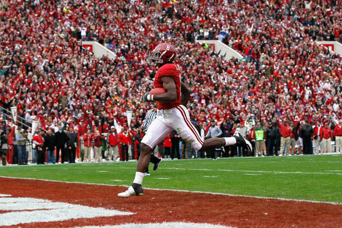 TUSCALOOSA AL - NOVEMBER 26:  Julio Jones #8 of the Alabama Crimson Tide crosses the goal line for a touchdown against the Auburn Tigers at Bryant-Denny Stadium on November 26 2010 in Tuscaloosa Alabama.  (Photo by Kevin C. Cox/Getty Images)