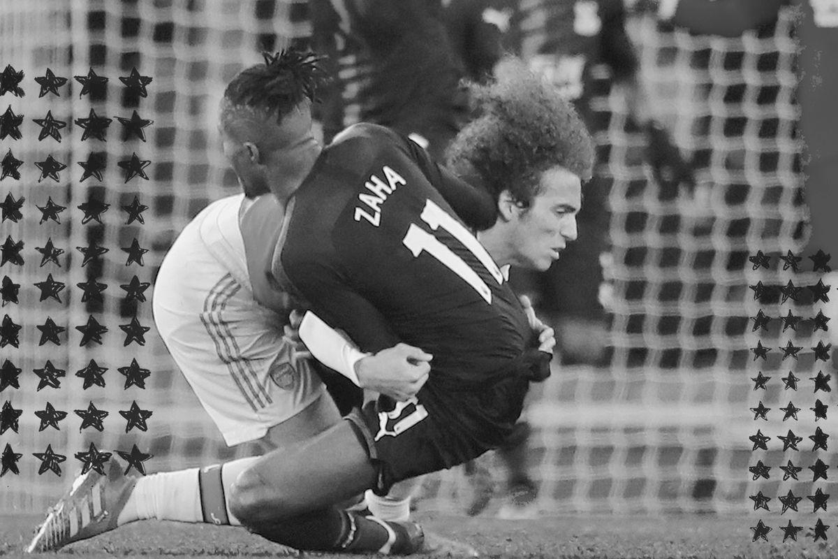 Arsenal's Matteo Guendouzi tackles Crystal Palace's Wilfried Zaha