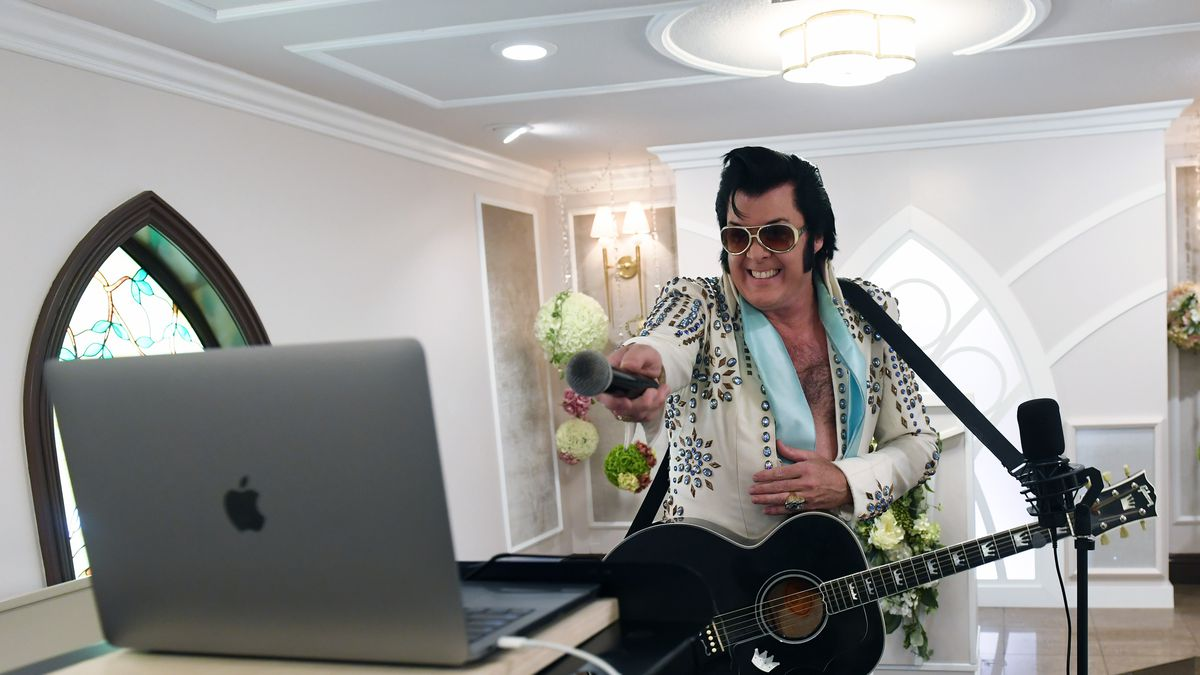 An Elvis impersonator appears over Zoom at a vow renewal ceremony in Las Vegas in July.