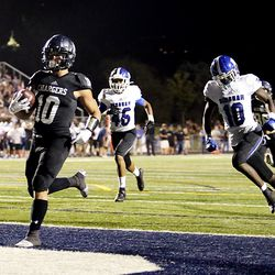 Corner Canyon's Austin Bell crosses the goal line for a touchdown as Corner Canyon and Bingham play a high school football game at Corner Canyon on Friday, Aug. 30, 2019. Corner Canyon won 56-28.