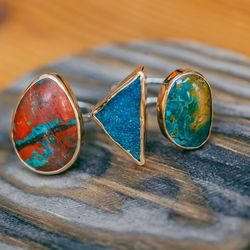 """<b>Melissa Joy Manning</b> Limited Edition 14kg Chrysocolla Ring, <a href=""""http://shopbird.com/product.php?productid=28131&cat=0&manufacturerid=184&page=1"""">$385</a> and One-of-a-Kind Turquoise Ring, <a href=""""http://shopbird.com/product.php?productid=28676"""