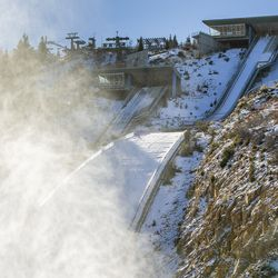 Snow machines blow man-made snow at the base of the ski jumps at the Utah Olympic Park near Park City on Monday, Nov. 30, 2020.