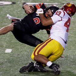 USC Trojans defensive lineman Tuli Tuipulotu (49) sacks Utah Utes quarterback Jake Bentley (8) at Rice-Eccles Stadium in Salt Lake City on Saturday, Nov. 21, 2020.