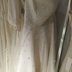 Bridal gown with beaded flower details, $3,245 (was $6,490)