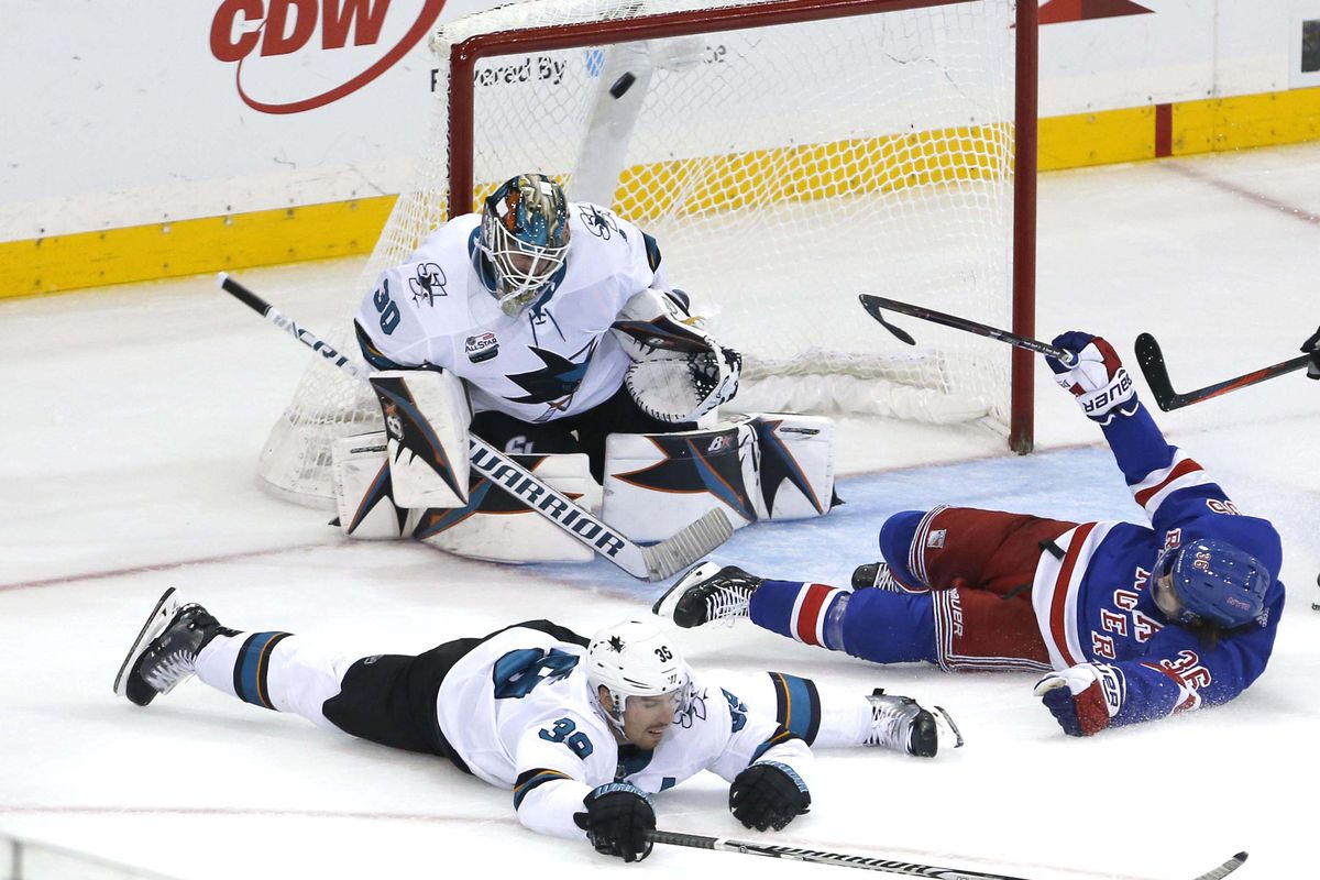 Oct 11, 2018; New York, NY, USA; A shot by New York Rangers defenseman Brady Skjei (76) (not pictured) gets by San Jose Sharks goaltender Aaron Dell (30) to win the game in overtime at Madison Square Garden. The New York Rangers won 3-2