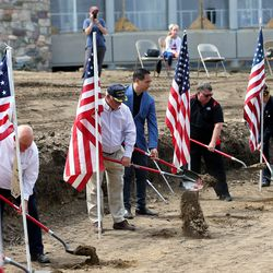 Utah Attorney General Sean Reyes, center,joins other officials and community members in breaking ground for theBountiful Veterans Parkin Bountiful on Tuesday, May 26, 2020.