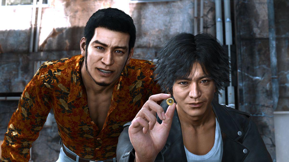 Masaharu Kaito and Takayuki Yagami looking at a small round trinket in Lost Judgment
