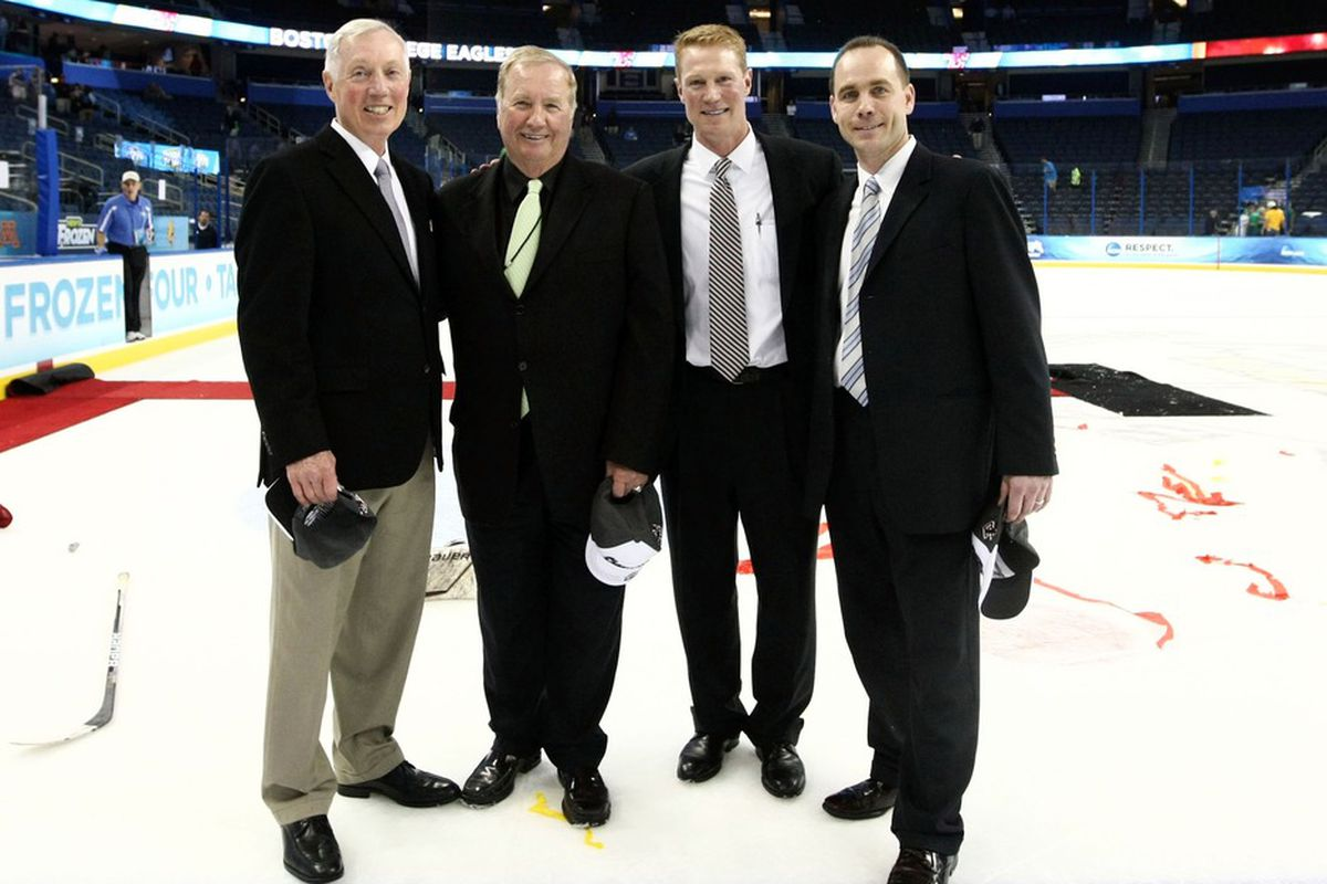Jerry York, far left, after the Eagles won the 2012 NCAA Championship.