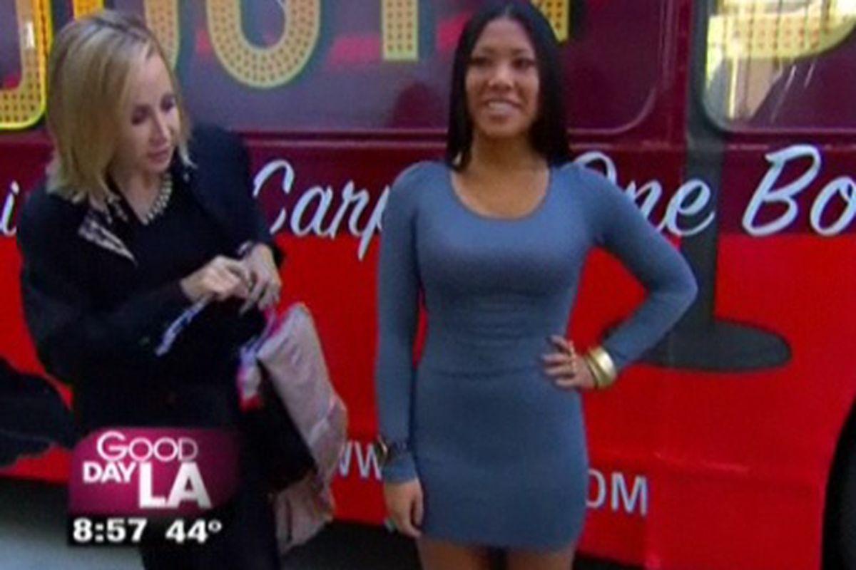 "Brave woman. Screenshot via <a href=""http://www.myfoxla.com/dpp/good_day_la/spanx-red-carpet-booty-bus-on-gdla-20110222"">Good Day LA</a>"