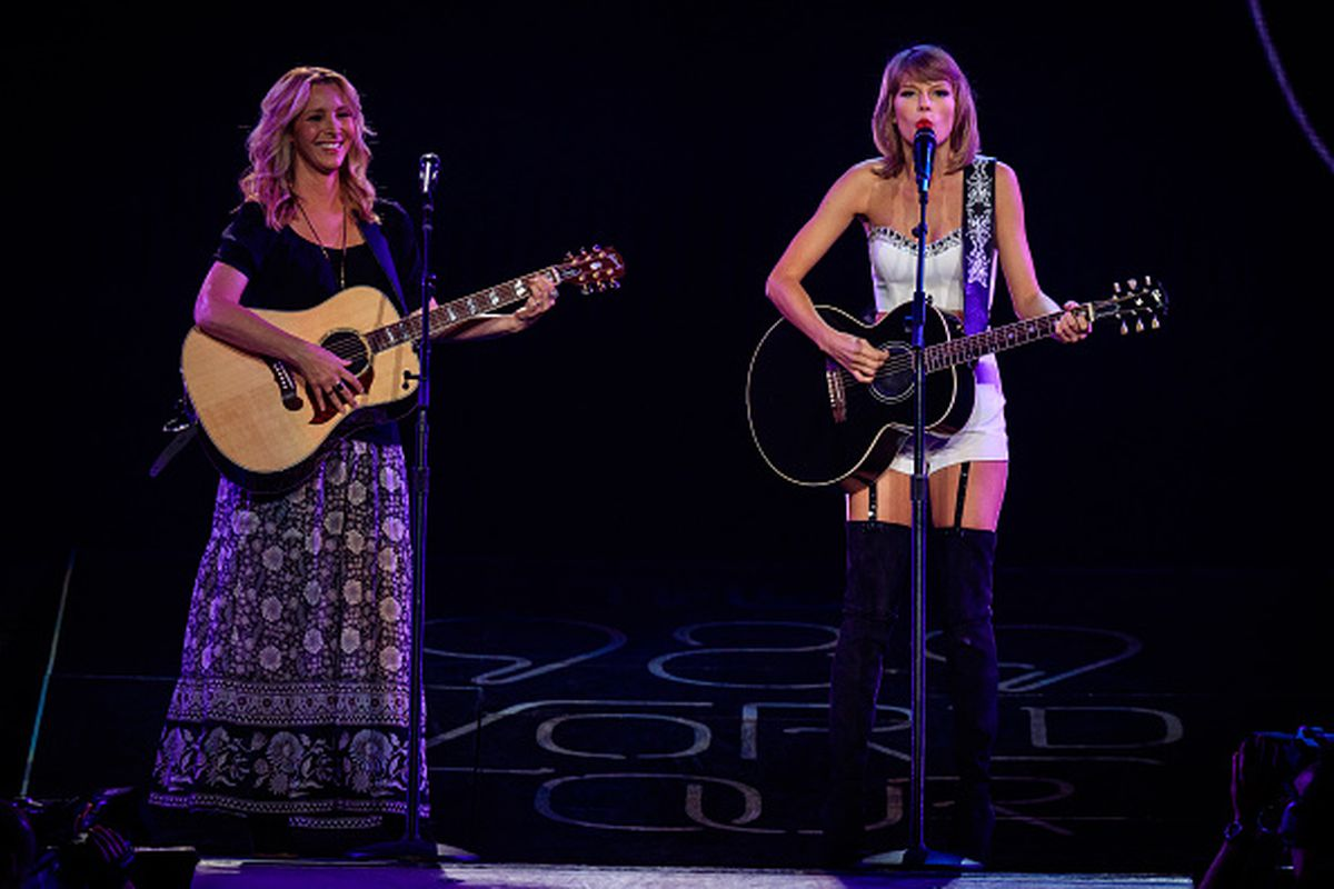 Actress Lisa Kudrow (L) and singer-songwriter Taylor Swift perform onstage during Taylor Swift The 1989 World Tour Live In Los Angeles at Staples Center on August 26, 2015 in Los Angeles, California.