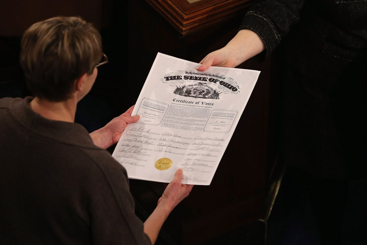 Congressional clerks passing around Ohio's Electoral College certificate.