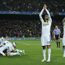 Chelsea's Fernando Torres from Spain, left, unseen, celebrates his goal with Jose Bosingwa  from Portuga, second right, Raul Meireles, right, and  team mates, during a Champions League second leg semifinal soccer match against Barcelona at Camp Nou stadium, in Barcelona, Spain, Tuesday, April 24, 2012.