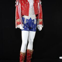 Red, white, and blue hot pants: Liberace donned this patriotic ensemble in 1986 as a tribute to the 100th anniversary of the Statue of Liberty. The embellishments of silver bugle beads and crystals give the illusion of separate garments, but the hot pants