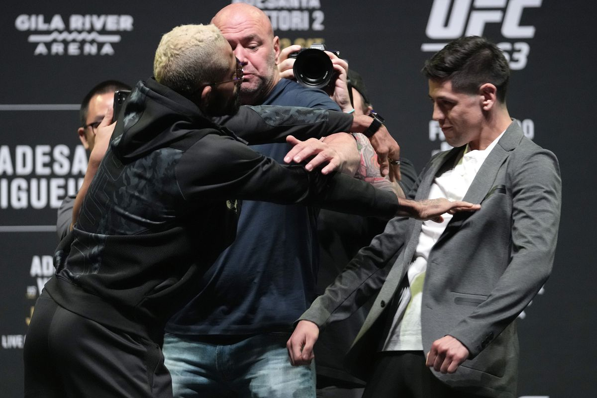 Opponents Deiveson Figueiredo of Brazil and Brandon Moreno of Mexico face off during the UFC 263 press conference at Arizona Federal Theater on June 10, 2021 in Phoenix, Arizona.